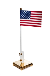 Flagpole with the U.S. flag and engraving on two sides of the foot